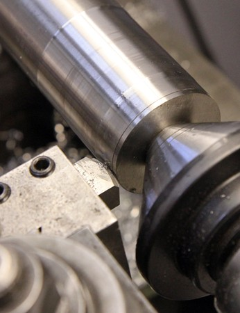 A custom machined titanium plug allows the cutter better access to the end of this head tube