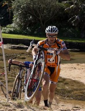 Australian Sid Taberlay runs up a beach course in Manly, Sydney