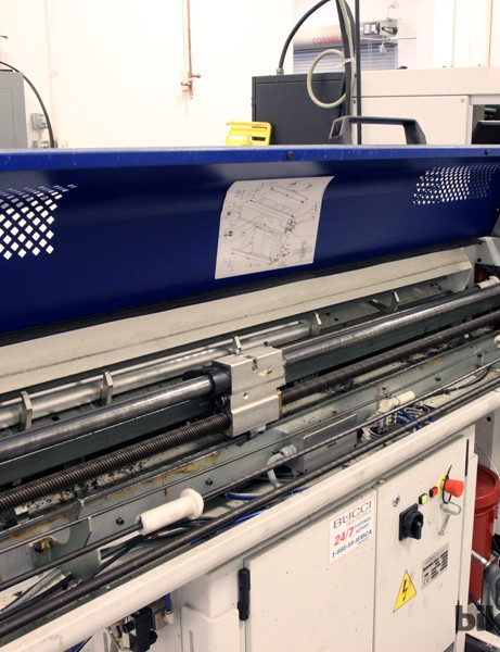 Rod stock is fed into a CNC lathe here