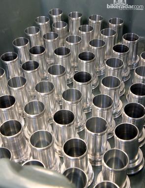 Shiny aluminum bottom bracket cups fresh out of the CNC machine