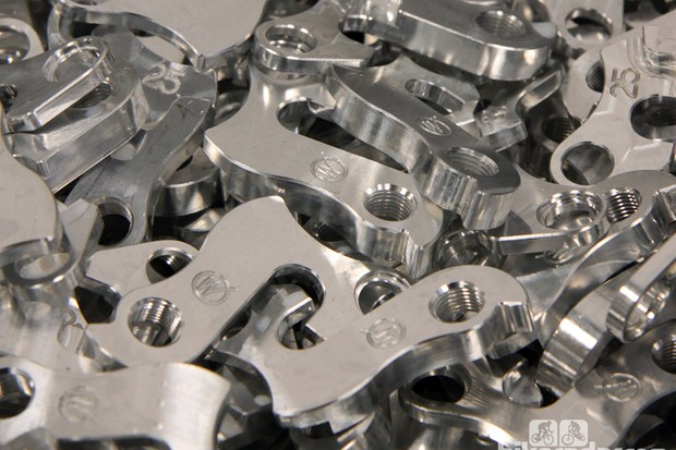 Many stock rear derailleur hangers are cheaply made from cast aluminum, making them prone to failure. Wheels Manufacturing has earned a solid following for its aftermarket hangers thanks the use of more durable 6061 alloys and precision machining