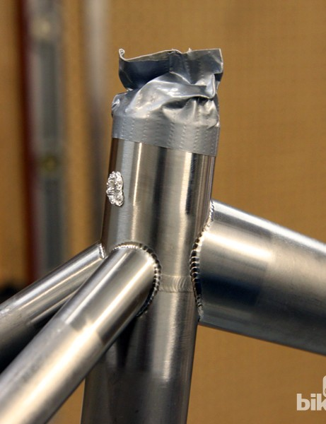 It's critical when welding titanium that it be done in an inert environment. Otherwise, the weld region can become oxidized and brittle, leading to possible failures down the road. In this case, argon gas is injected down by the bottom bracket and most of the other open ports on the frame are sealed off with tape or aluminum foil