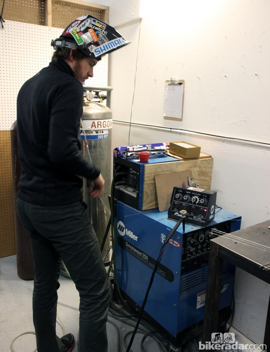 Aaron Barcheck checks his settings before starting to weld