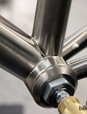 Barcheck builds every titanium frame with double-pass welds. The joints between the bottom bracket shell and the seat tube and down tube are fusion welded to start - meaning they're joined using only the welding torch. Barcheck does a second pass later using welding rod to reinforce the area, as seen in the joint between the seat tube and down tube