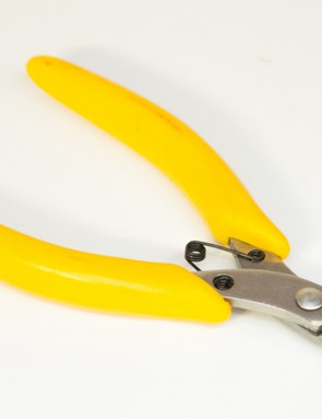 Using flush cutters to snip zipties smoothly is all about safety. They're inexpensive and are available in most hardware or hobby stores
