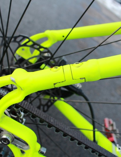 Unlike a singlespeed bike with a chain that can be assembled around the chain stay, Spot's belt bikes have an opening to insert and remove the belt