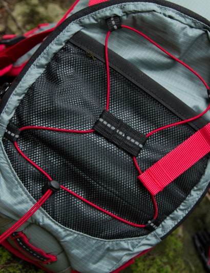 The outer section has an elastic mesh storage pocket and a bungee cord to hold a lightweight jacket or similar