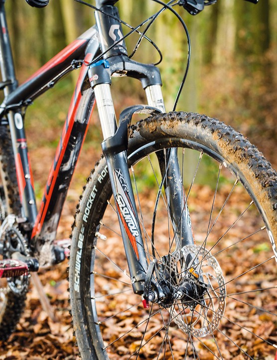 Suntour's coil-sprung XCR fork is basic in damping terms but it'll take some abuse