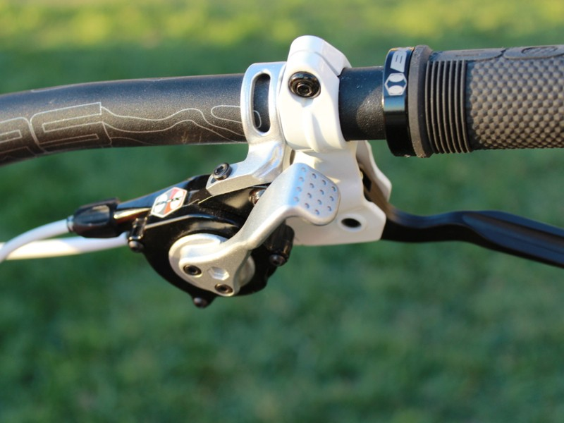 The Box shifter works by pressing the thumb lever forward like normal, but then releases by pressing the lever in towards the stem