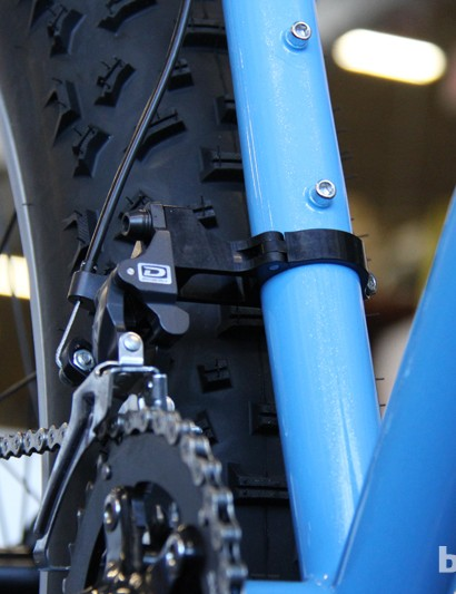 An adapter is used to position the direct mount front derailleur far outboard of the massize tyres