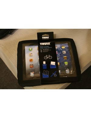 Thule's Pack n' Pedal iPad case clips onto a handlebar binding so riders can pedal and play on their tablet at the same time. Thule says it's a winner with the turbo training crew who need a case that's watertight. Which the Pack n' Play is