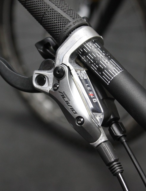 Shimano have chosen to combine the shifter and brake lever into one unit to save weight and handlebar space