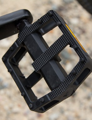 The Stromlo does include pedals, but their basic plastic construction offers limited grip and durability off-road