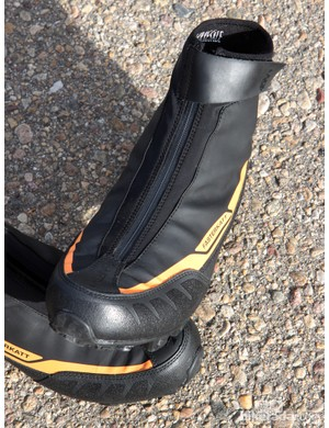The outer shell features a waterproof cover and armoring at the heel and toe