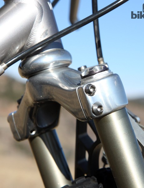 Machined titanium hardware secures the spindly 26mm-diameter aluminum legs
