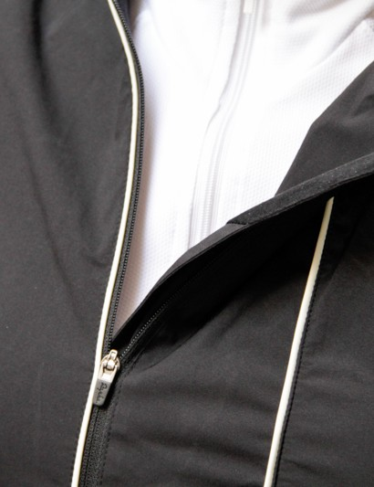 The off-centre zip is disguised by the reflective piping