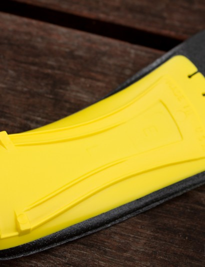 The Yellow insole's plastic arch support and heel cup