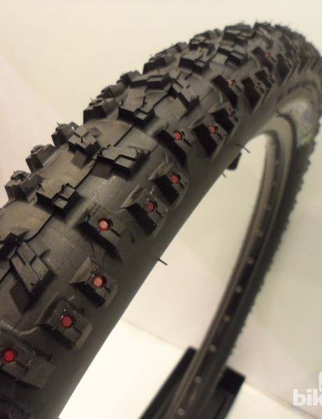 The Innova Downhill LITTLE Monster tyre has red studs to improve cornering grip