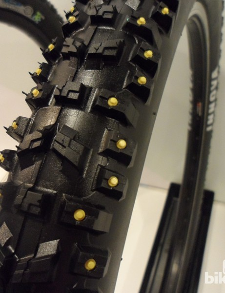 The prominent yellow studs of the Downhill BIG Monster are designed to aid stability in wet or snowy conditions
