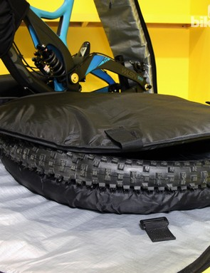 Wheels are secured on either side of the frame. Thick pieces of foam and sturdy plastic caps keep the wheels from damaging the frame while inflatable airbags on the outside provide lightweight padding for the whole package