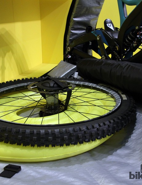 Wheels are strapped securely in place with Biknd's 'hub cap' system. Here, the protective inflatable airbag is shown without its usual woven nylon cover