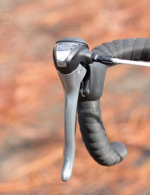 Five of the bikes tested feature Tiagra shifters - these use an older ergonomic design from Shimano; expose the cable straight out of the shifter; and are the best shifter to still offer gear indicators