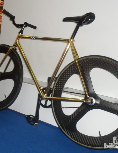 The Woho bikes Emperor features a 24k gold finish over its triple-butted 4130 frame