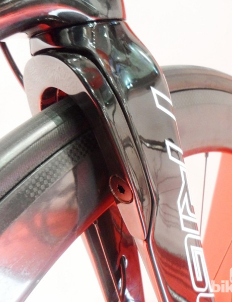 On the rear of the TR235's fork is a U-shaped plate that bolts into place when running discs
