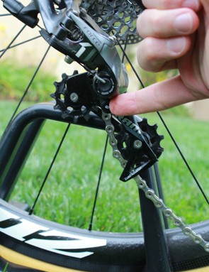 A simple button locks out the derailleur cage