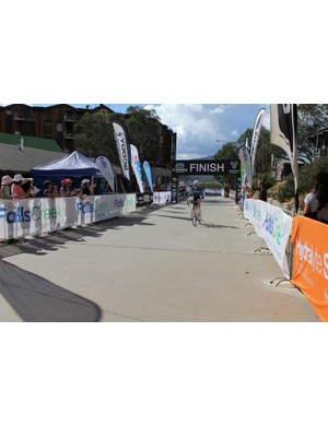Tani Ruckle crossing the finish line
