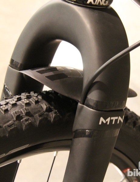 The front brake line is held in place with a very clean-looking integrated fender