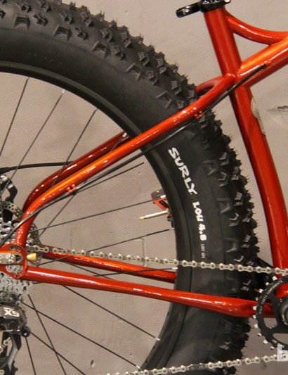 The rear end is short and tucked close to the bent seat tube and Henry's fat bike