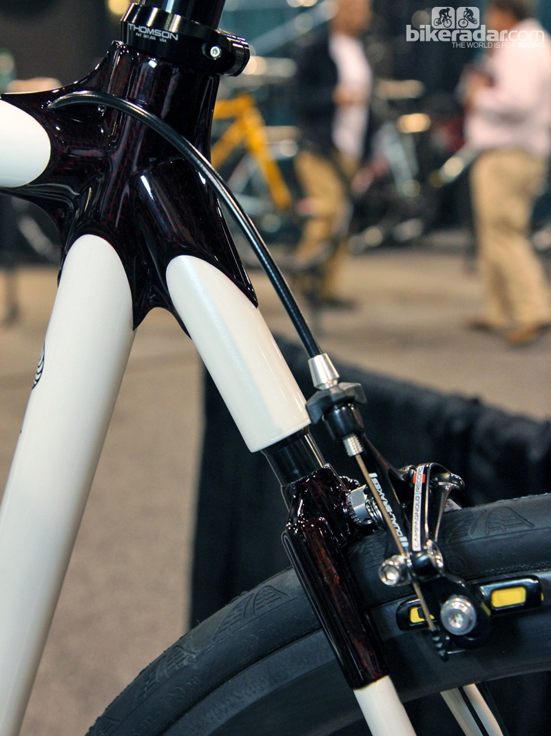 Calfee tucks a spring into the seat stay wishbone of its top-end Manta Pro. Different springs are available to accommodate different rider weights and ride preferences