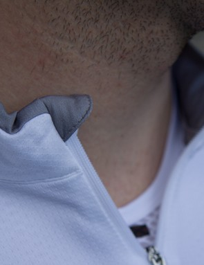The zipper features overlapping material to prevent any skin or stubble irritation