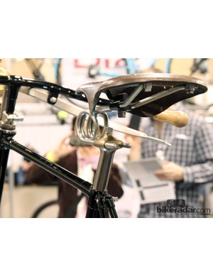 Note how the upper clamp of the seatpost head wraps around the bottom of the saddle rails to create a seamless look