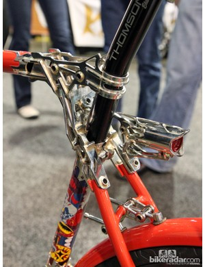 The seatpost binder is tucked away down where the seat stays are attached to the seat tube. A reinforcing collar is used up top for support. Detail on the brake bridge is incredible
