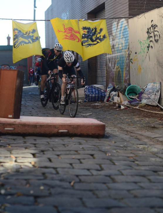 Two riders tackle one of the many cobbled sectors of the Melburn Roobaix
