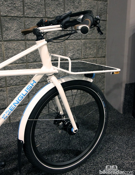 The huge front rack is rigidly fixed to the frame and doesn't turn with the front wheel