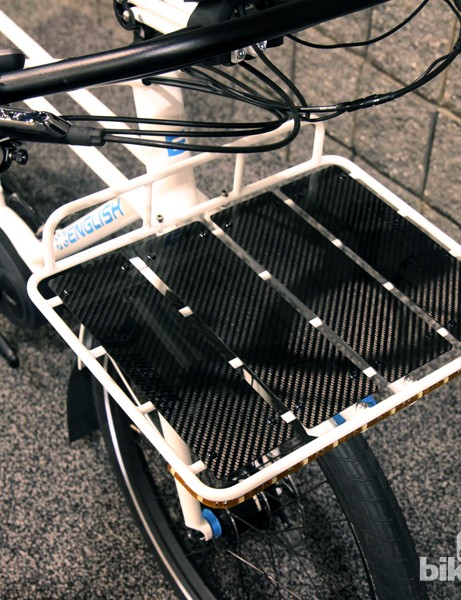 English covered the front and rear racks with carbon fiber decking from Ruckus Composites