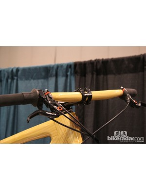 Connor builds wooden handlebars using a similar method of layering wood plies with Kevlar fabric