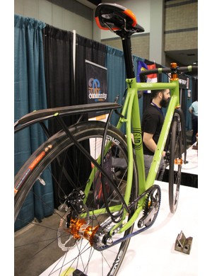 Wide, curved seatstays are one of Syndrome Cycles hallmark design features. Note the made-to-made rack