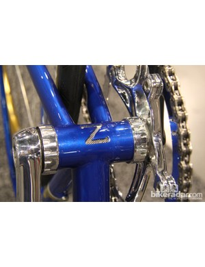 Zukas carves a 'Z' into his bottom brackets. It functions as a drainhole. The stainless mesh aids in keeping debris out