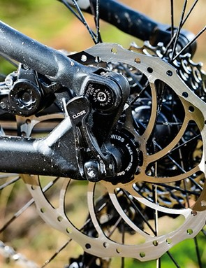The post-mount rear brake is nestled out of harm's way