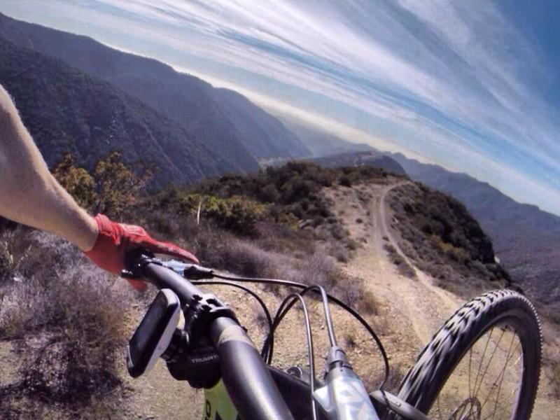 Specialized/Redbull enduro racer Curtis Keene demonstrates the importance of a secure Garmin mount when mountain biking. Keene uses Pro Mount Billet's top cap mount