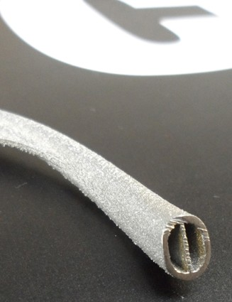 The 3D printed titanium rails are designed with Airbus. The wall thickness is just a millimetre and they weigh a third of the amount of a standard titanium rail