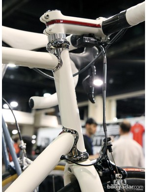 Polished stainless steel lugs set off the pearlescent white paint on this Ellis Cycles road bike