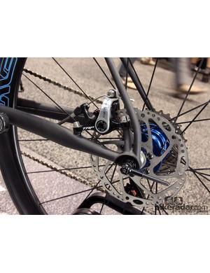 The TRP Spyre rear disc brake mounts to a pair of tiny stalks