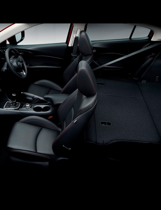 Inside the cabin of the all-new Mazda3 Hatchback, the seats fold flat for flexible load space