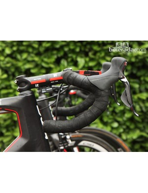 Phinney opts for 3T's shallow-drop Ergosum Team carbon handlebar, wrapped with two layers of tape