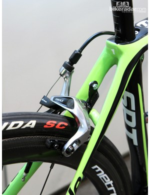 SRAM Red brake calipers are equipped with carbon-specific pads. Note the carbon fiber number plate holder, too